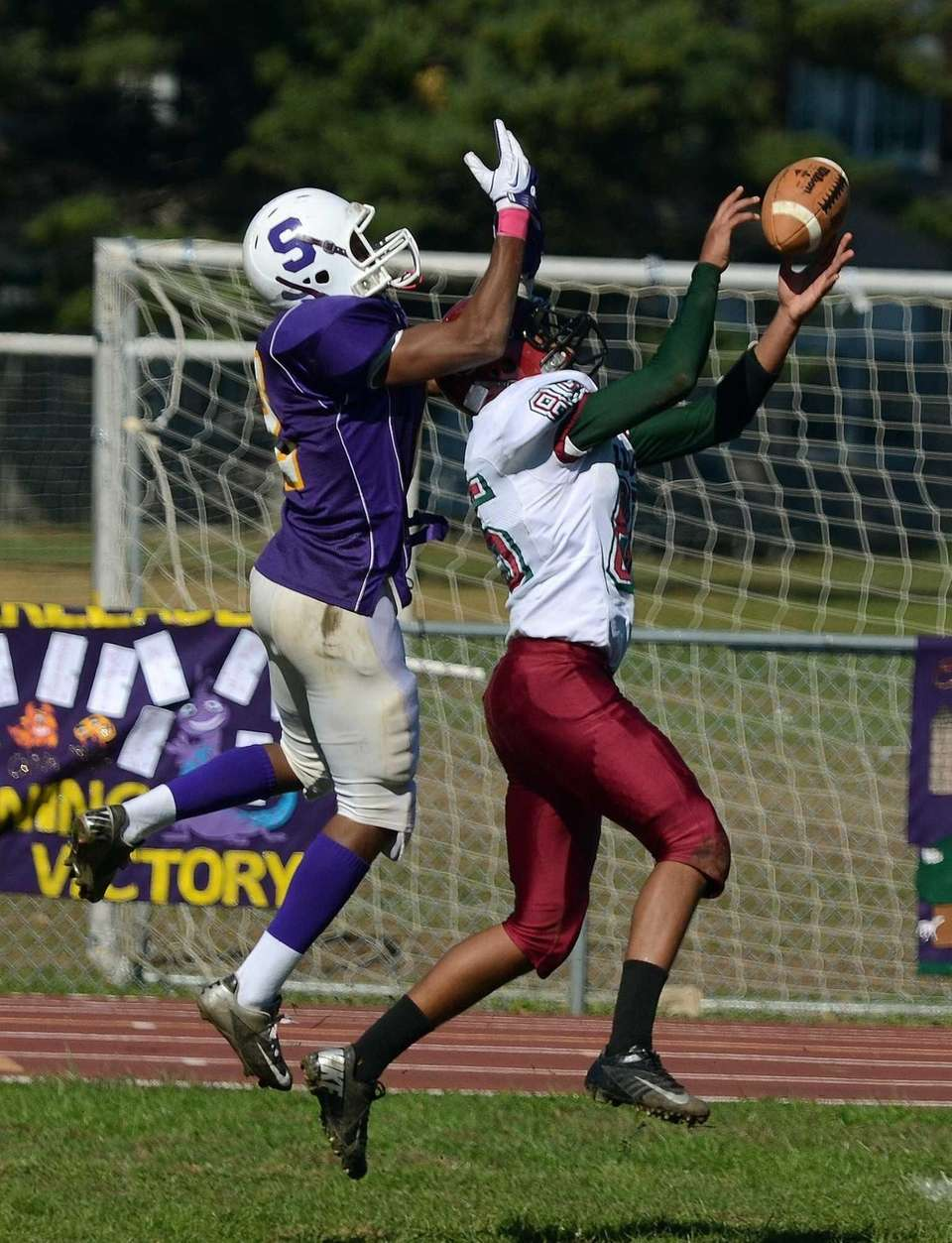 Glen Cove's Mike Burrell intercepts a pass intended