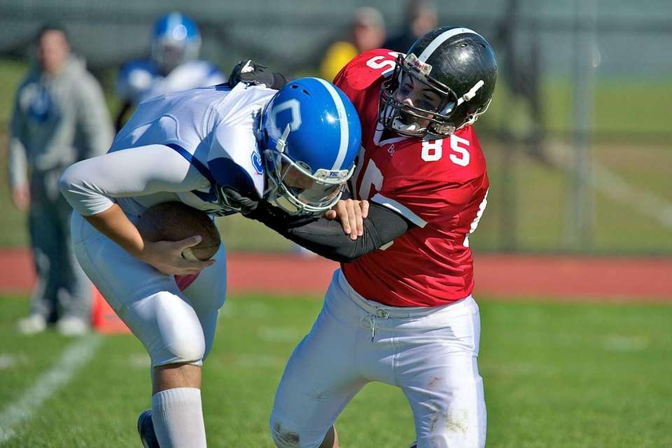 Syosset defensive end Bradley Balogh sacks Valley Stream