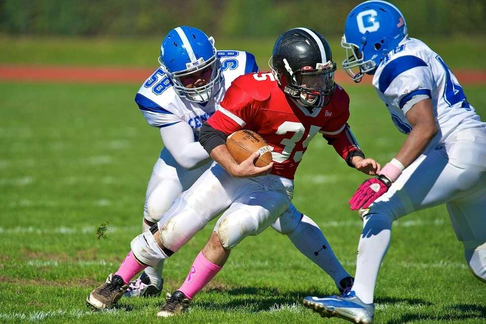 Syosset runningback Joe Morris breaks a tackle attempt