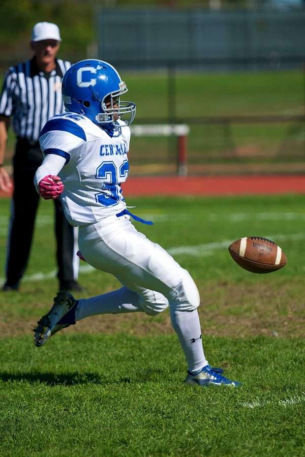 Valley Stream Central kicker Deshawn Newton punts the