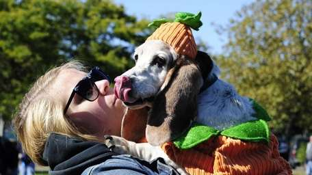 Sammy, 12, gives some kisses to her owner,