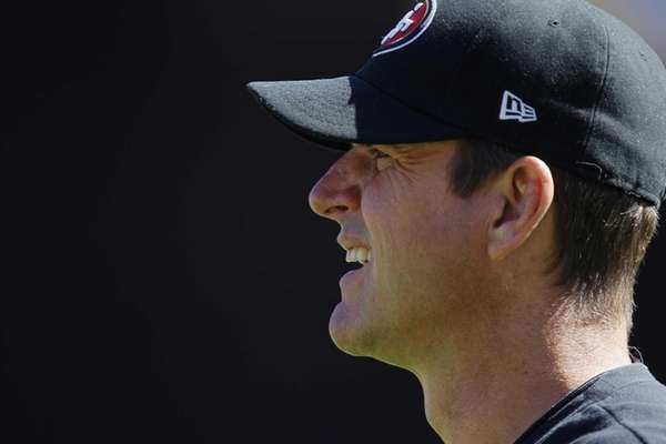 San Francisco 49ers head coach Jim Harbaugh watches