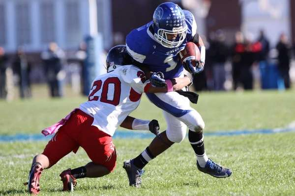 Riverhead's Jaron Greenidge, right, is tackled by Newfield's