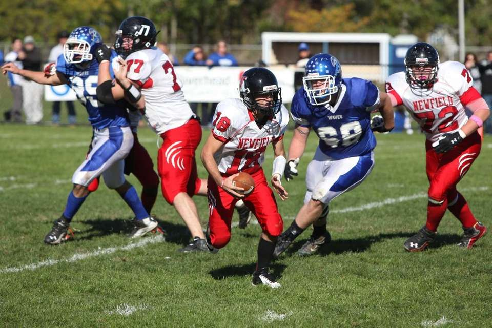 Newfield's Brandon Riggi runs the ball in a