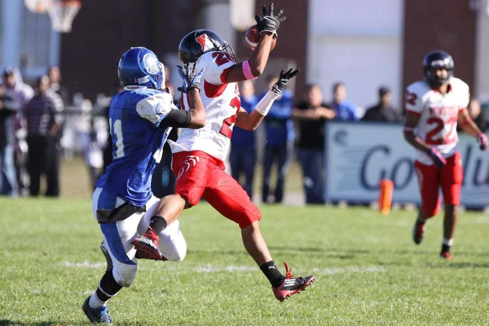 A pass intended for Riverhead's Jaron Greenidge, left,