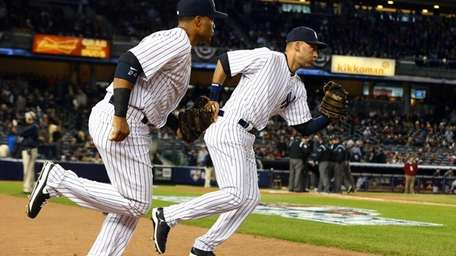 Derek Jeter and Robinson Cano take the field