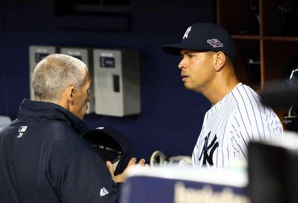 Alex Rodriguez talks with manager Joe Girardi before