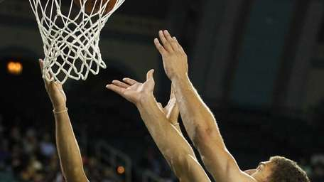 Deron Williams and Brook Lopez attempt to grab