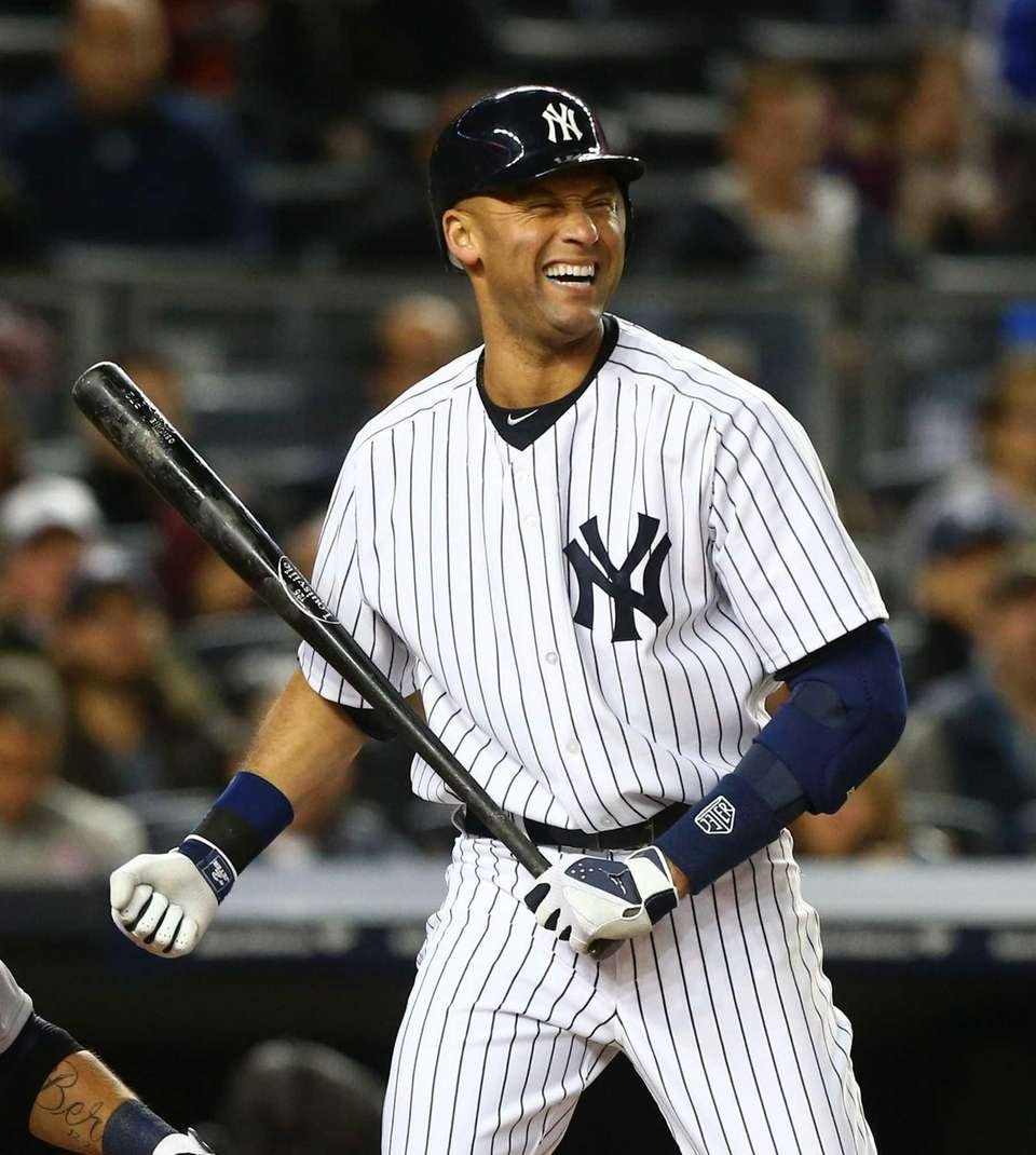 Derek Jeter reacts to a called strike during