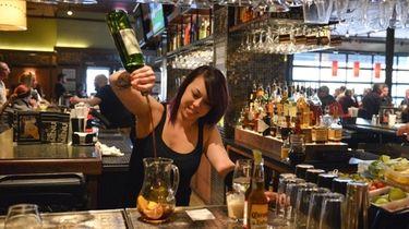Bartender Teresa Welter mixes a pitcher of sangria