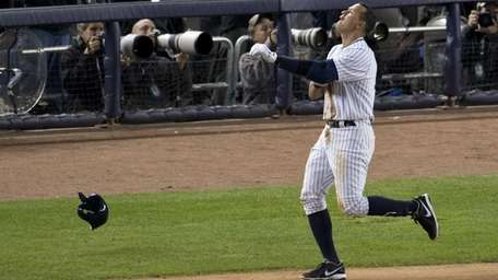 Alex Rodriguez reacts after hitting into a fielder's