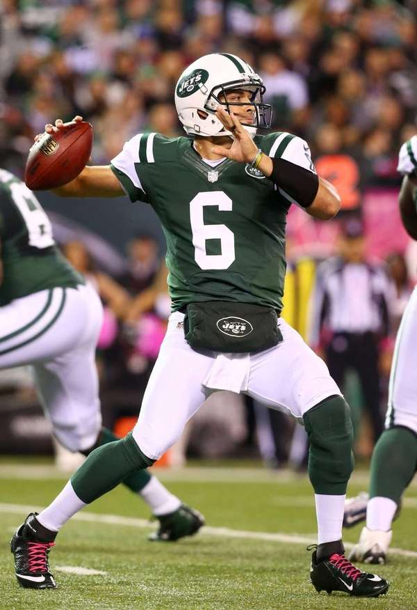 Mark Sanchez throws a passes against the Houston