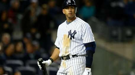Alex Rodriguez walks back to the dugout as