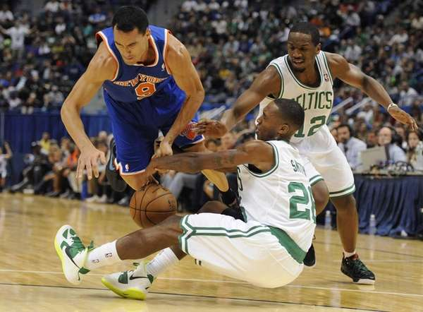 New York Knicks' Pablo Prigioni, top left, chases