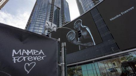 Graffiti and a mural memorialize former NBA star