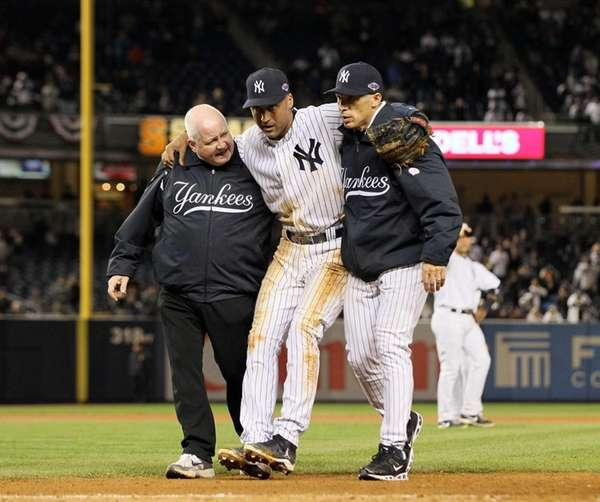 Derek Jeter is helped off the field in