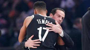 Nets head coach Kenny Atkinson embraces guard Garrett