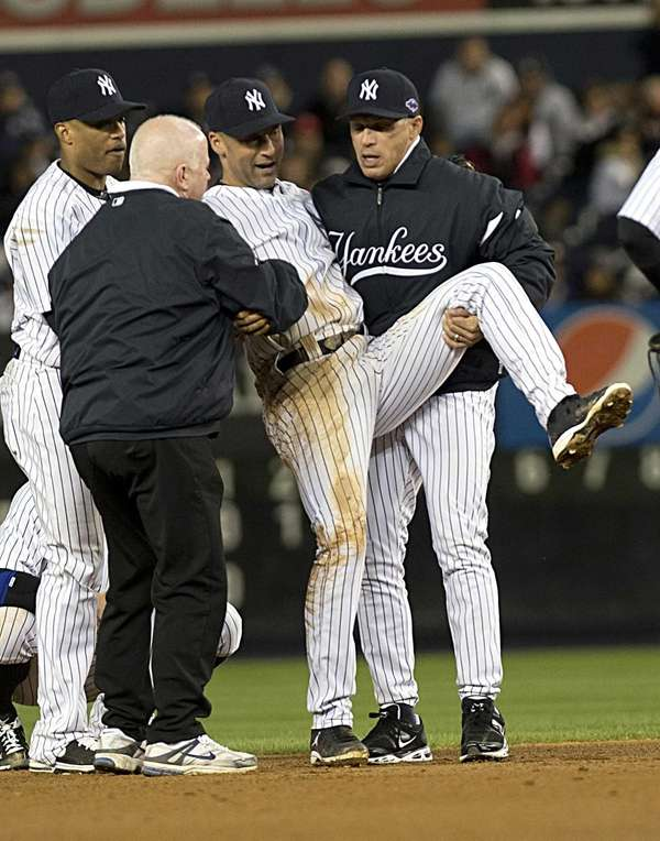 Derek Jeter is carried off the field after