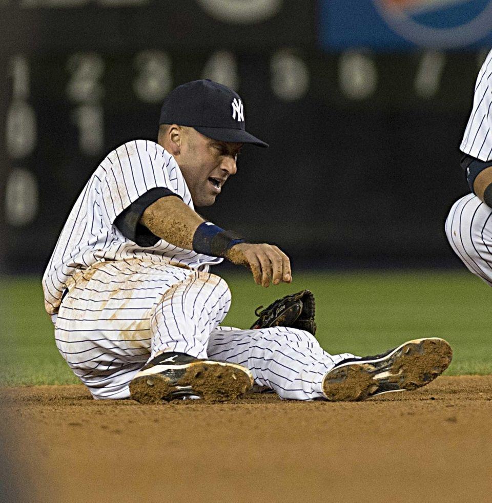 Derek Jeter injures himself while fielding a ball