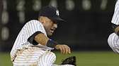 Derek Jeter injures himself while fielding a ball