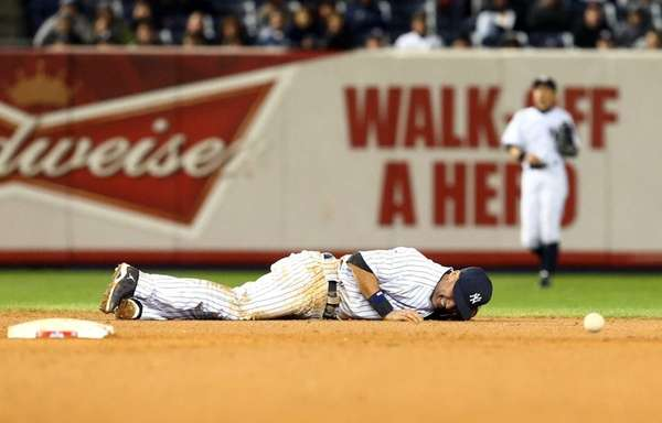 Derek Jeter lays on the ground in pain