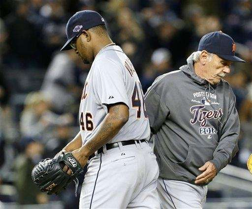 Detroit Tigers relief pitcher Jose Valverde, left, passes