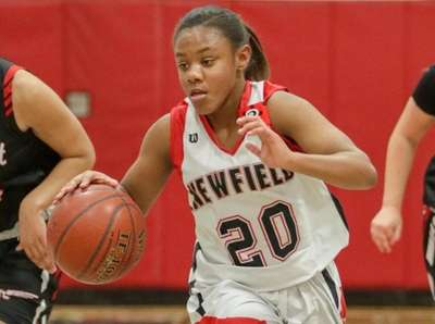 Newfield's Raiyah Reid #20 drives up court while
