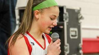 Newfield's Megan Spina #21 reads a statement prior
