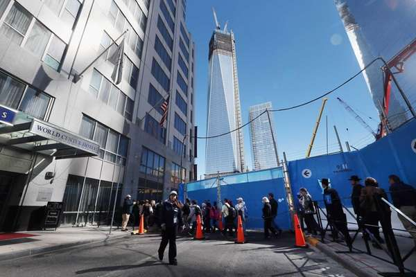 People wait in line to enter the 9/11