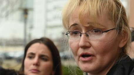 Justyna Zubko-Valva, mother of Thomas, speaks outside Family