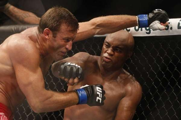 Anderson Silva, right, throws a punch at Stephan