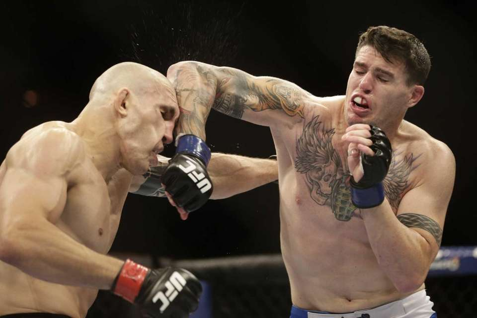 Chris Camozzi, right, lands an elbow on Luiz