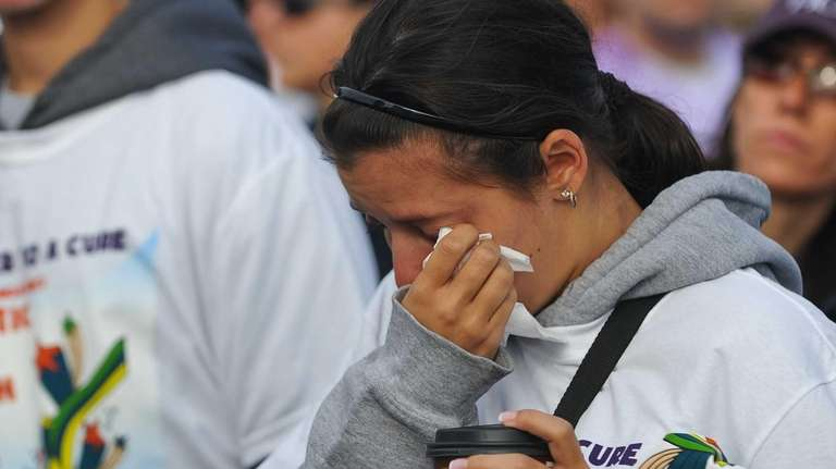 Cara Schmier of Carle Place gets emotional during