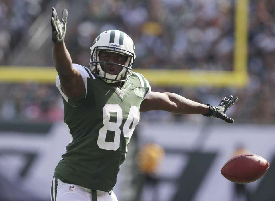Jets wide receiver Stephen Hill celebrates after making