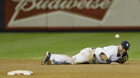 Yankees shortstop Derek Jeter reacts after injuring himself