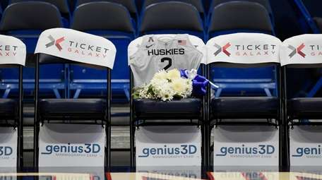 A seat with a jersey and flowers is
