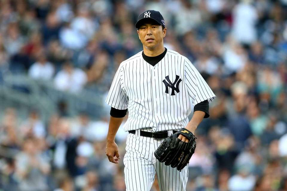 Hiroki Kuroda walks back to the dugout after