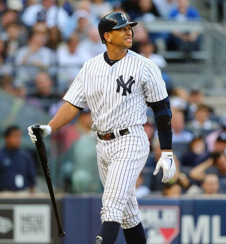 Alex Rodriguez walks back to the dugout after
