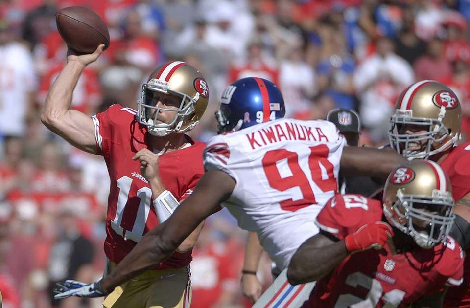 San Francisco 49ers quarterback Alex Smith passes as