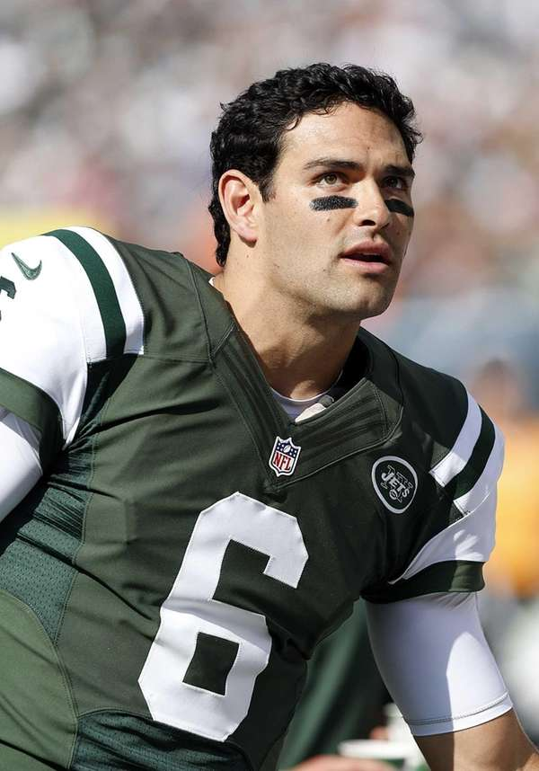 Jets quarterback Mark Sanchez on the sidelines during