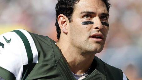 Jets quarterback Mark Sanchez on the sidelines during