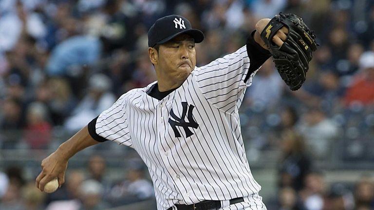 Hiroki Kuroda pitches during the first inning of