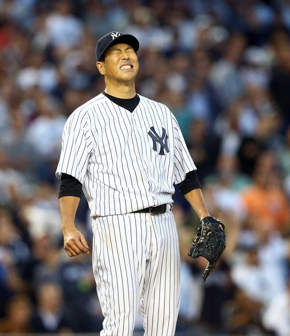 Hiroki Kuroda reacts after the Yankees failed to