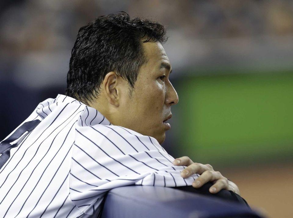 Hiroki Kuroda watches from the dugout during the