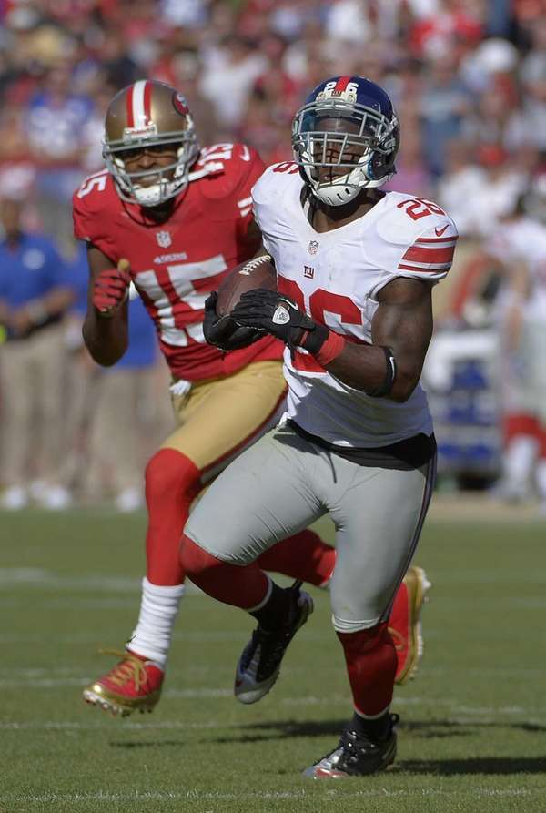 Giants safety Antrel Rolle returns an interception as