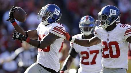 New York Giants free safety Antrel Rolle, left,