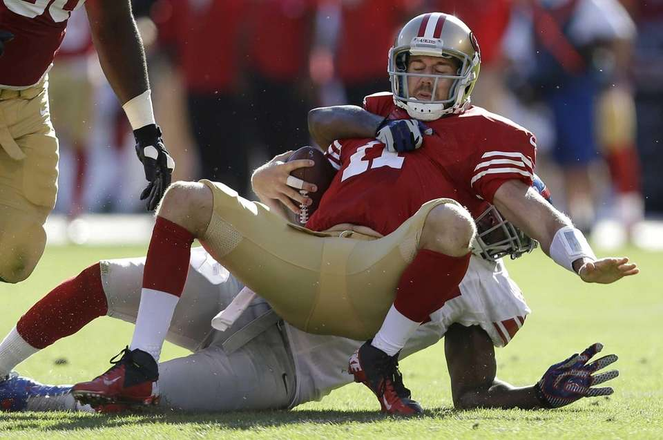 San Francisco 49ers quarterback Alex Smith is sacked