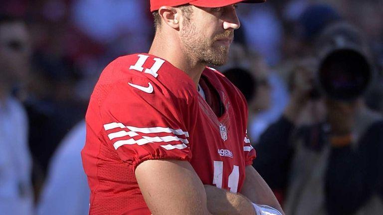 San Francisco 49ers quarterback Alex Smith (11) stands