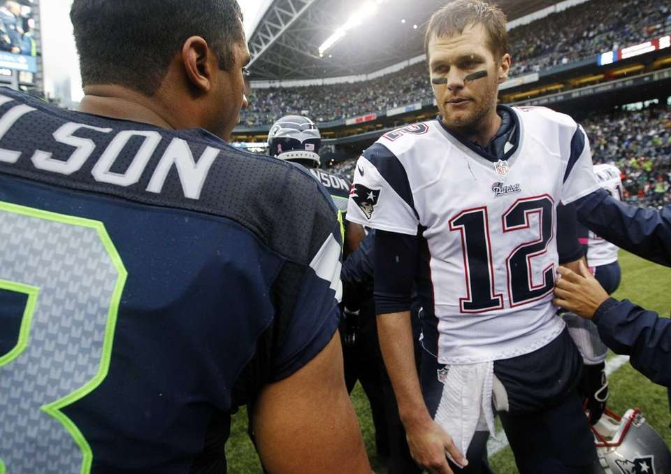 New England Patriots quarterback Tom Brady (12) talks