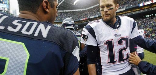 New England Patriots quarterback Tom Brady (12) talks